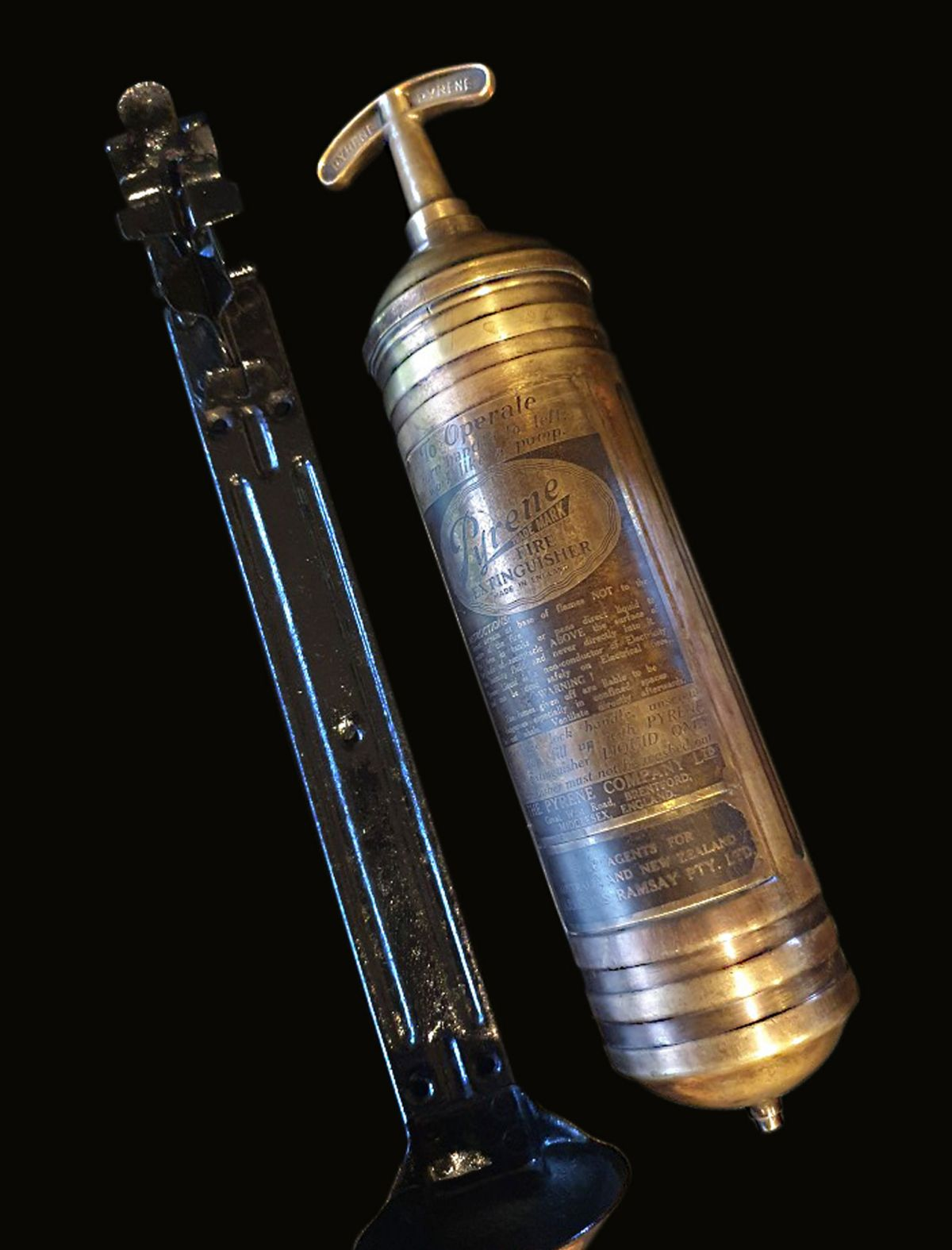 1940s PYRENE PORTABLE FIRE EXTINGUISHER WITH BULKHEAD BRACKET INSTALLED ABOARD THE AVRO LANCASTER